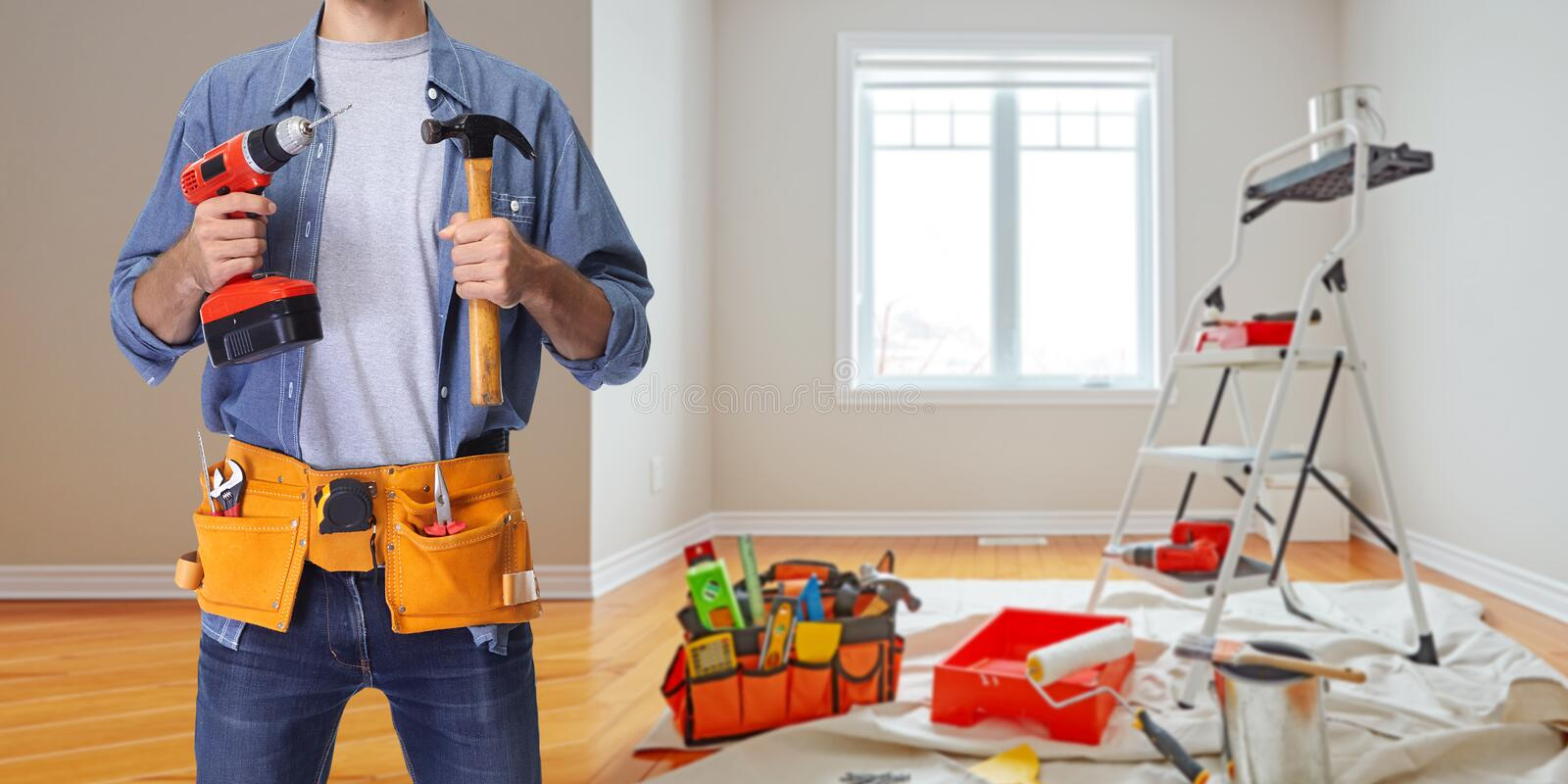 Construction worker with drill and hammer stock photo