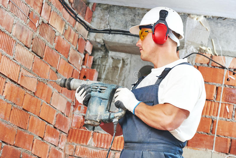 Construction worker with drill perforator royalty free stock image