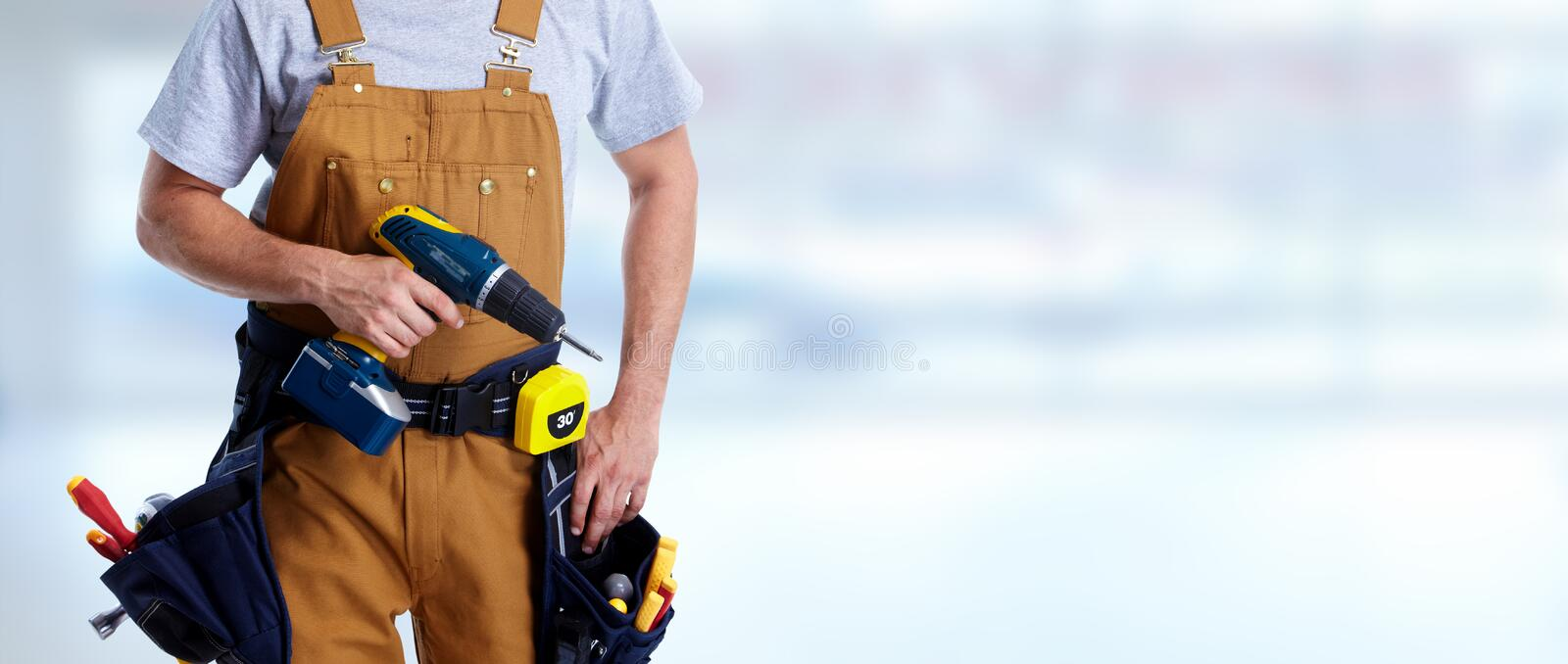 Construction worker with drill royalty free stock photos