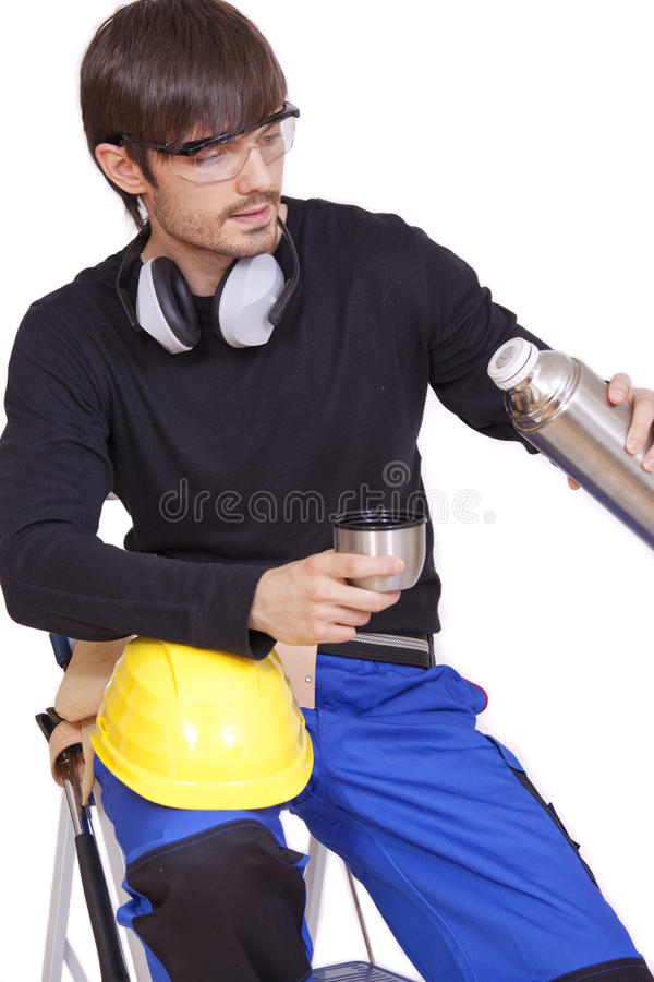 Construction worker drinking coffee royalty free stock photos