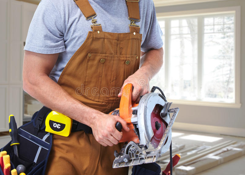 Construction worker with electric saw royalty free stock images