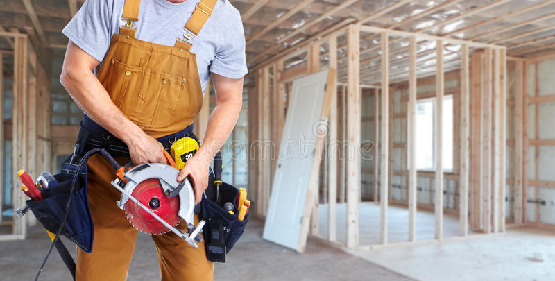 Construction worker with electric saw stock photos