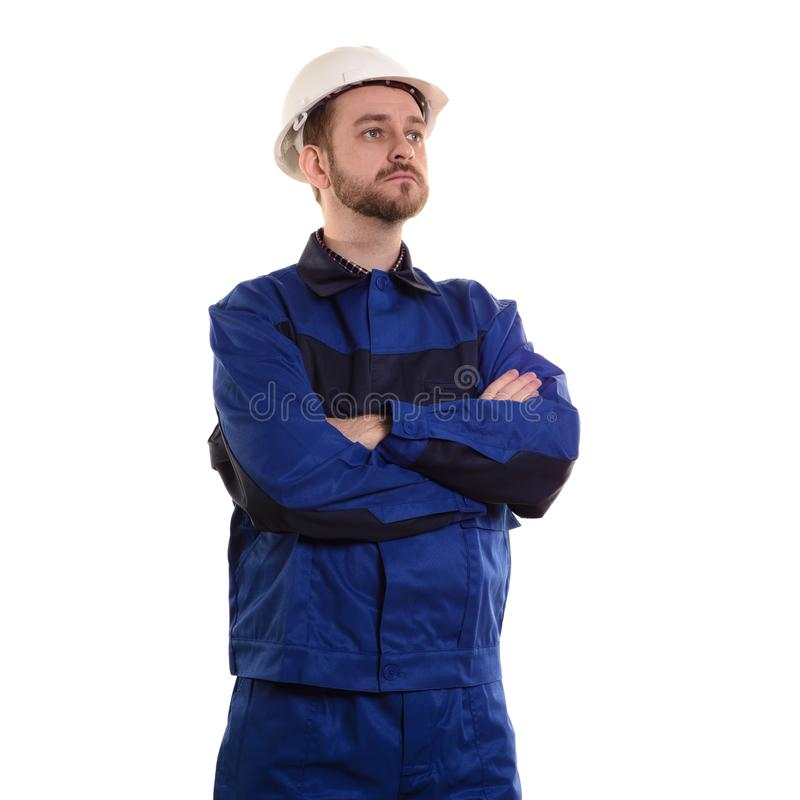 Construction worker Engineer-builder in a protective white helmet and blue uniform, on white stock images