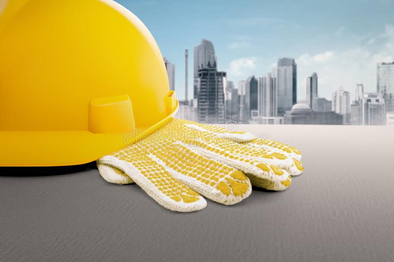 Construction worker equipment like hard hat and gloves. On the table royalty free stock images