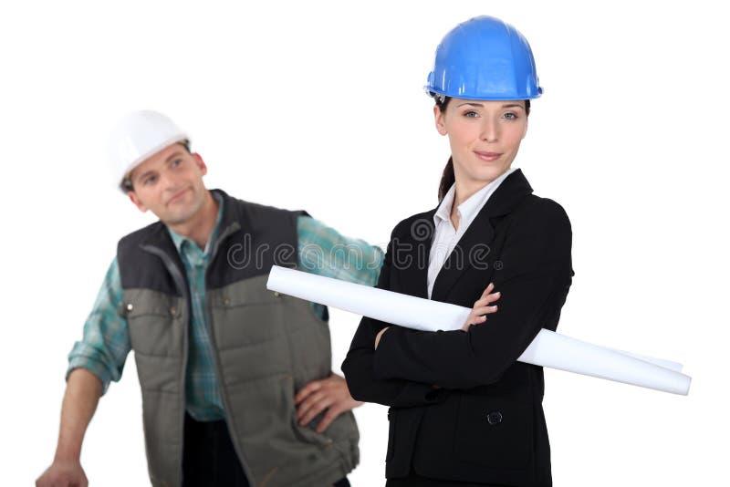 Construction worker flirting stock image