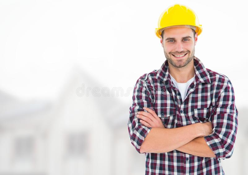 Construction Worker in front of construction site stock images