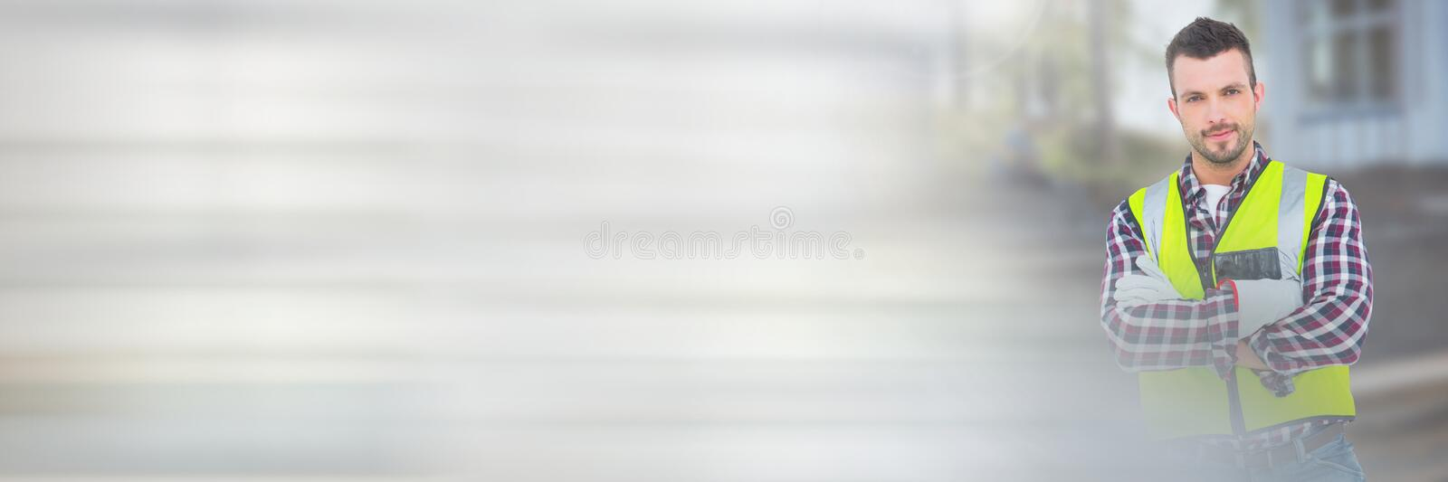 Construction Worker in front of construction site with transition effect stock photography