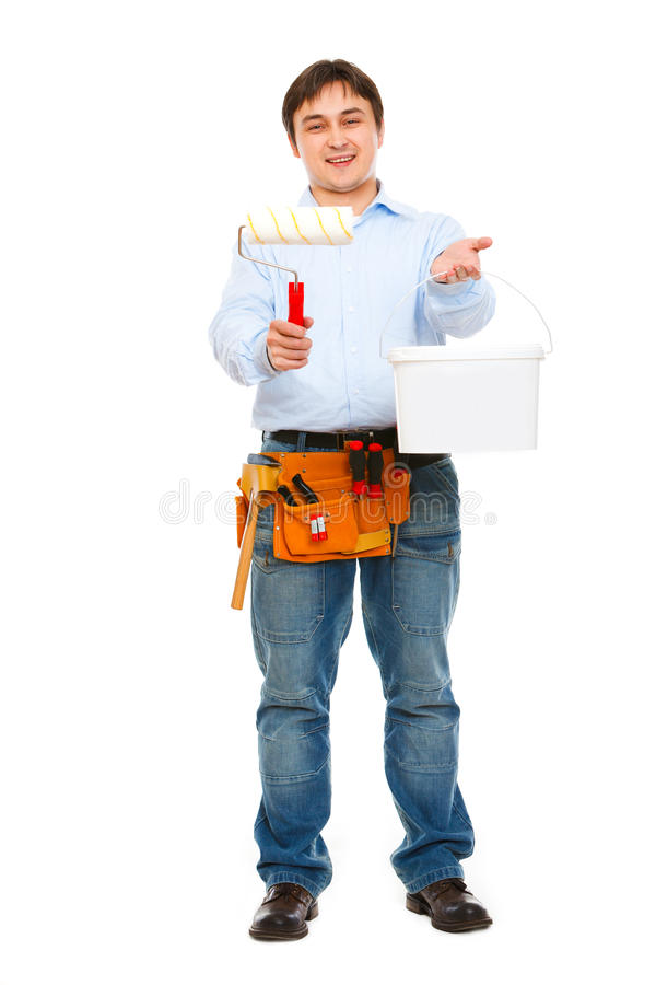 Download Construction Worker Giving Bucket And Brush Stock Photo - Image: 23332654