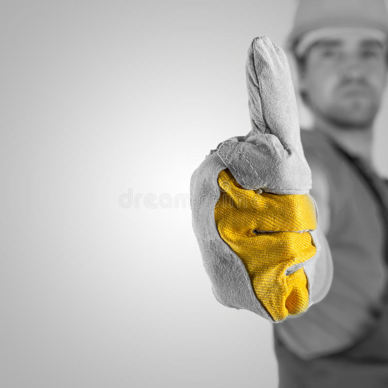 Construction worker giving a thumbs up royalty free stock image