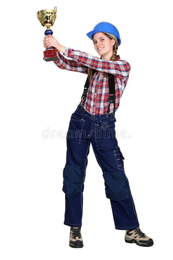 Construction worker with gold cup royalty free stock images