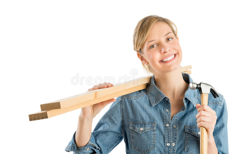 Download Construction Worker With Hammer Carrying Wooden Planks On Should Stock Photos - Image: 32145753