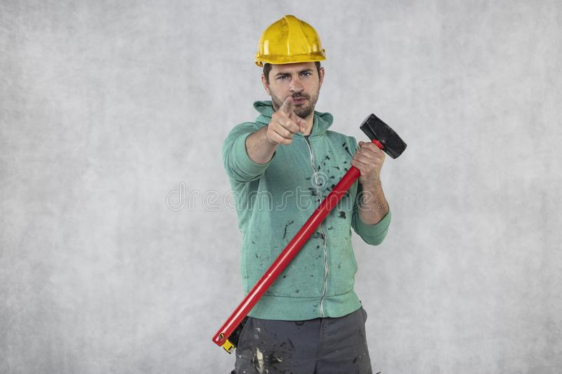 Construction worker with a hammer in hand, concept of construction and disassembly, renovation royalty free stock photos