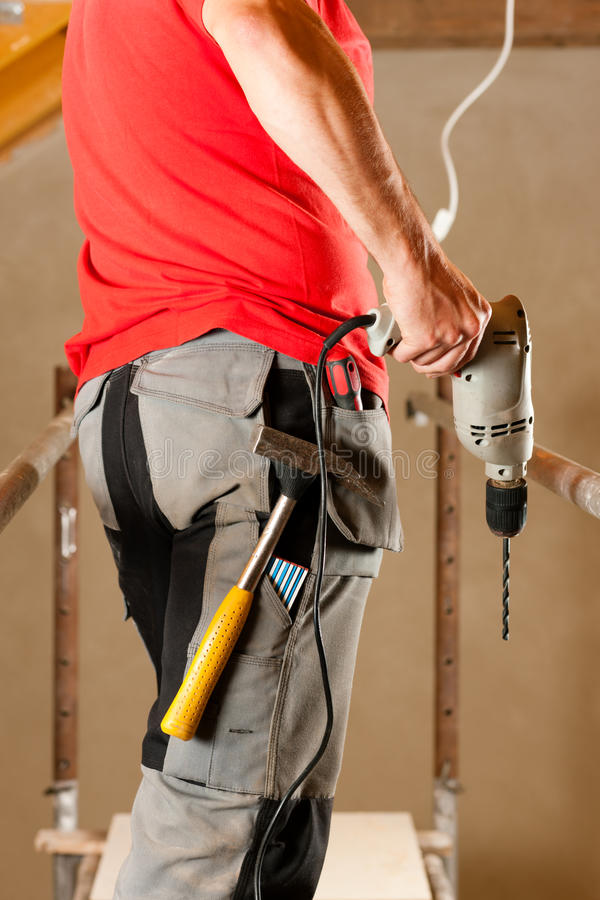 Construction worker with hand drill royalty free stock photo