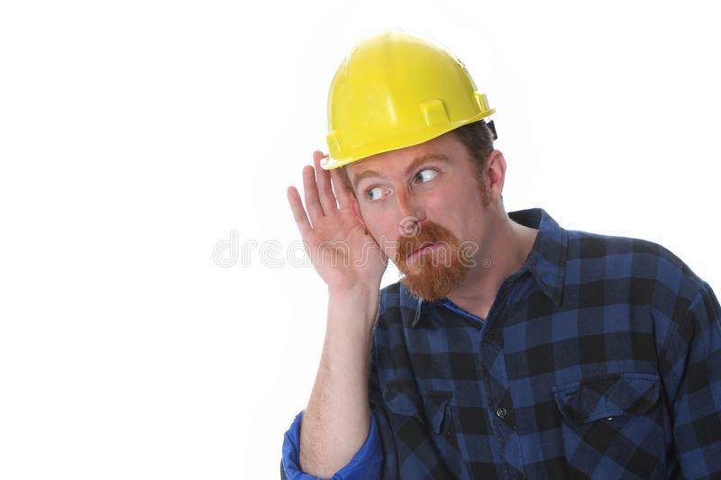 Construction worker with hand on ear royalty free stock photography