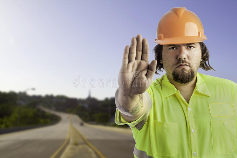 Construction Worker with hand out. City construction worker on white with his hand out showing stop royalty free stock photos
