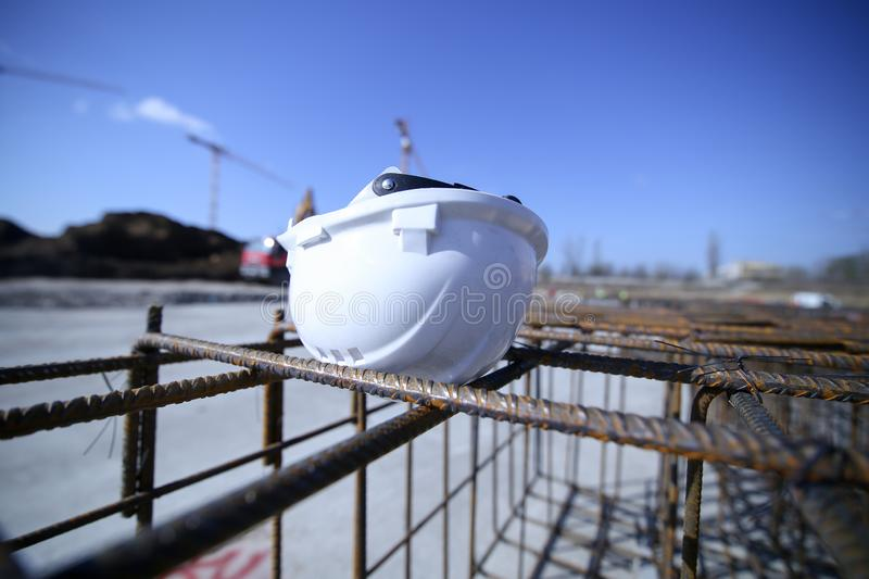 Construction worker helmet on top of a reinforcing iron stock photography