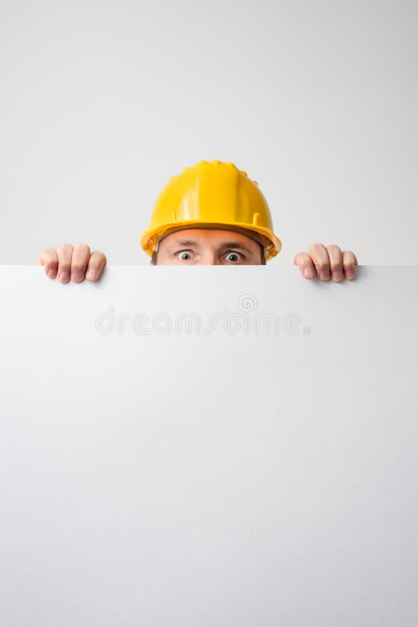 Worker holding blank board on white background royalty free stock photos
