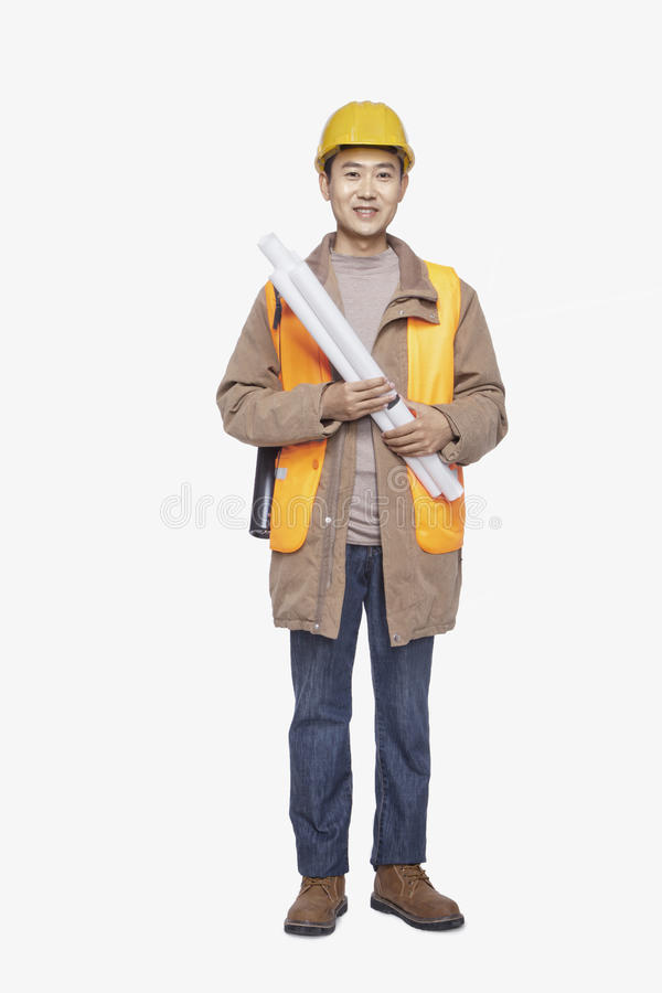Construction worker holding blueprint against white background, full- length portrait royalty free stock image