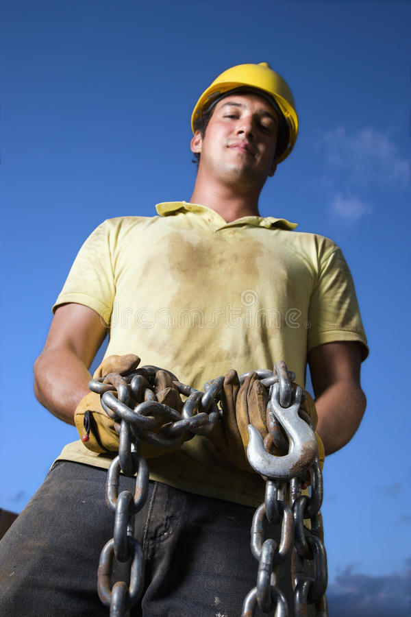 Download Construction Worker Holding Chain Stock Photo - Image: 12738590