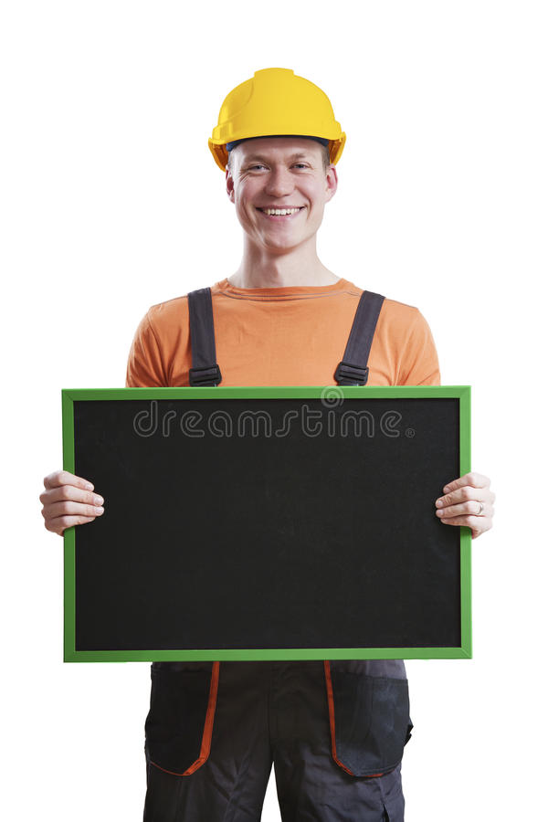 Construction worker holding chalkboard royalty free stock image