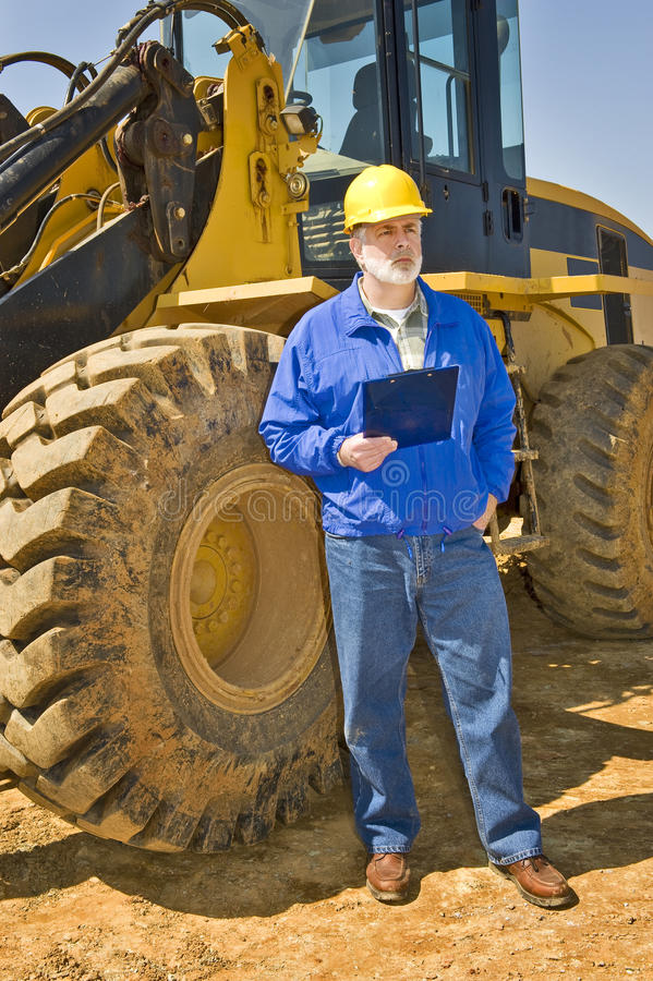 Construction Worker Holding Clipboard stock photography