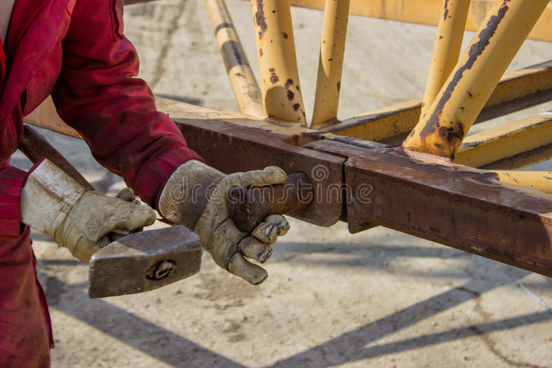 Construction worker holding hammer 2 stock images