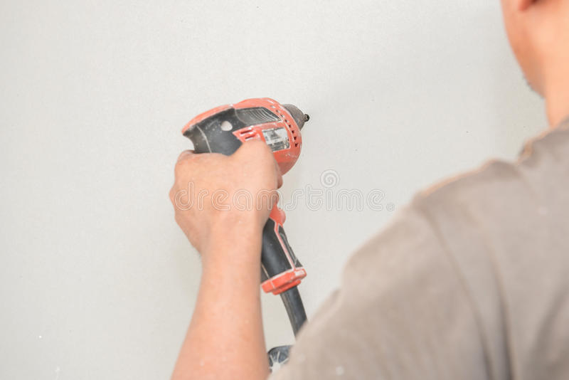 Construction worker holding the hand drill. S stock images