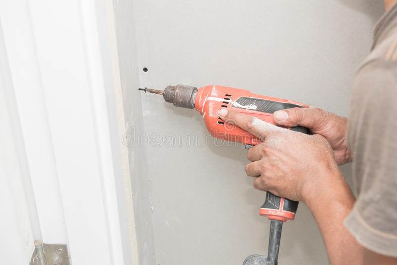 Construction worker holding the hand drill. S royalty free stock photography
