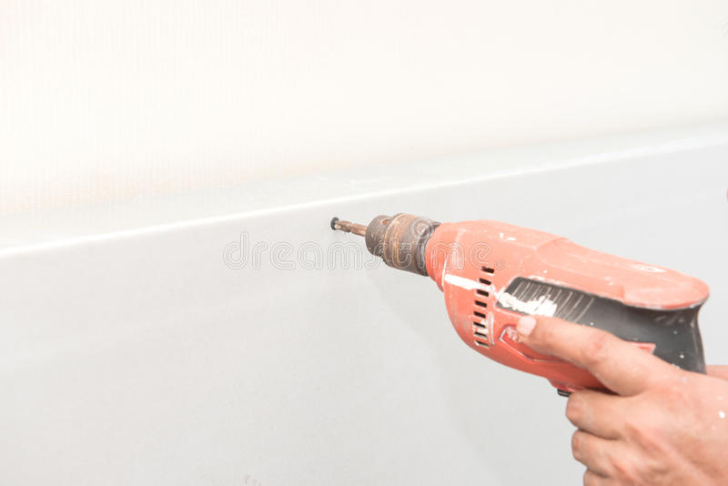 Construction worker holding the hand drill. S royalty free stock photos