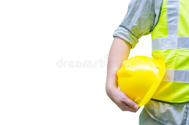 Construction worker holding hard hat with white background stock photo