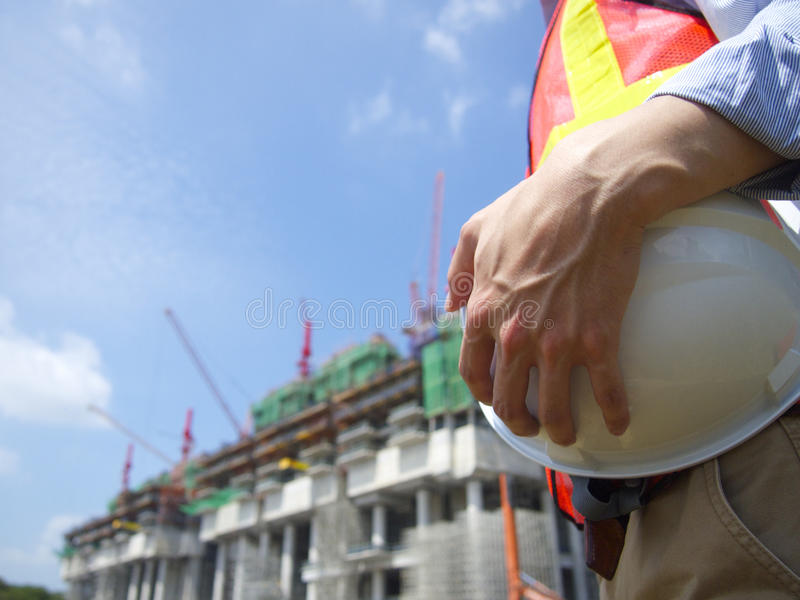 A construction worker holding a helmet royalty free stock photos