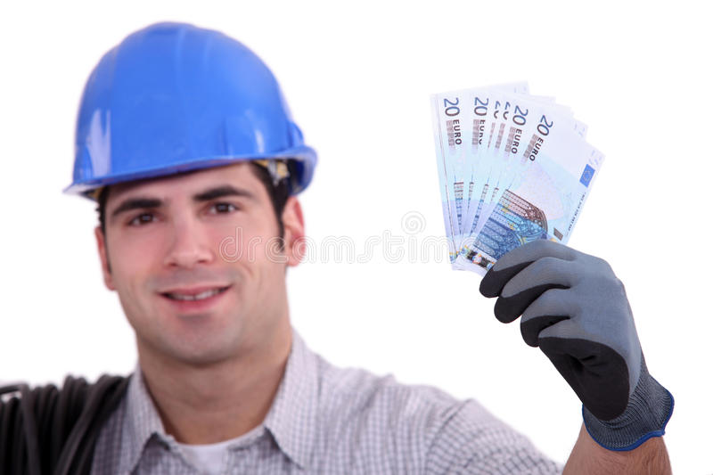 Construction worker holding money stock image