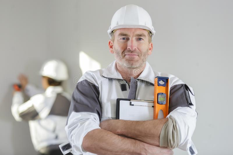 Construction worker holding spirit level stock images