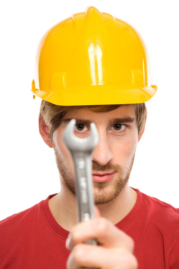 Construction worker holding wrench stock image