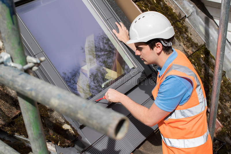 Construction Worker Installing Replacement Window stock photo