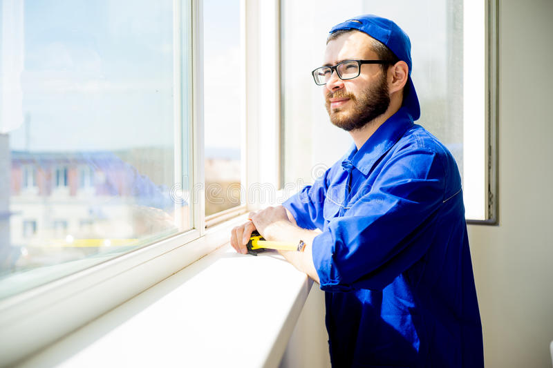 Construction worker installing window royalty free stock photo
