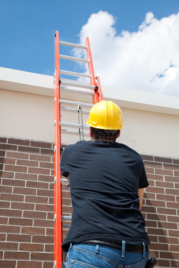 Construction Worker on Ladder stock image