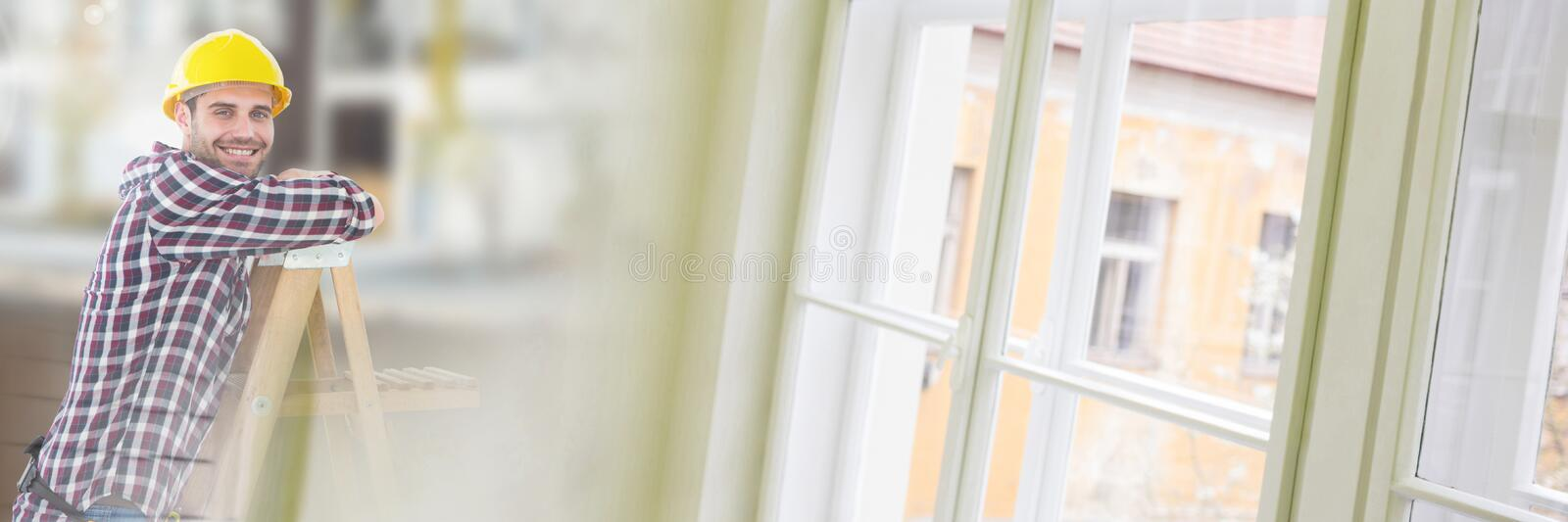 Construction Worker on ladder in front of construction site with window transition effect stock photos
