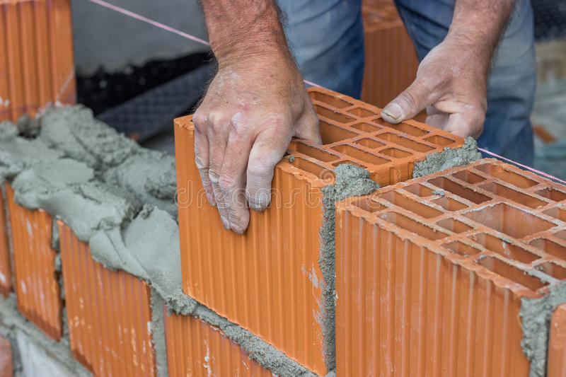 Construction worker laying hollow clay block 2 stock image