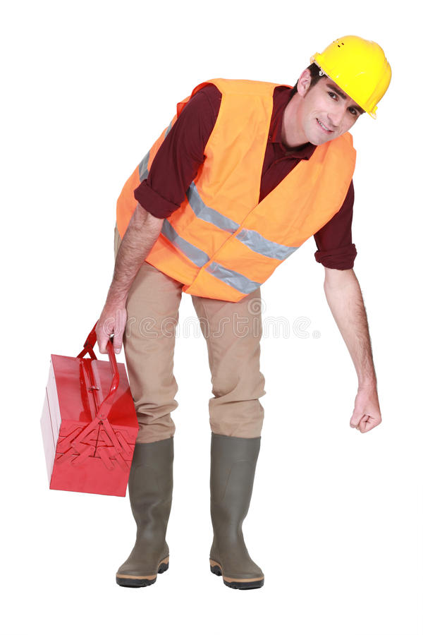 Construction worker lifting something royalty free stock image