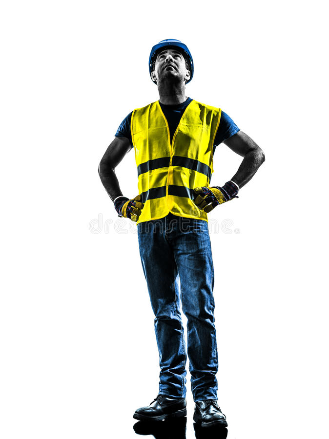 Construction worker looking up safety vest silhouette. One construction worker looking up with safety vest silhouette isolated in white background stock photos