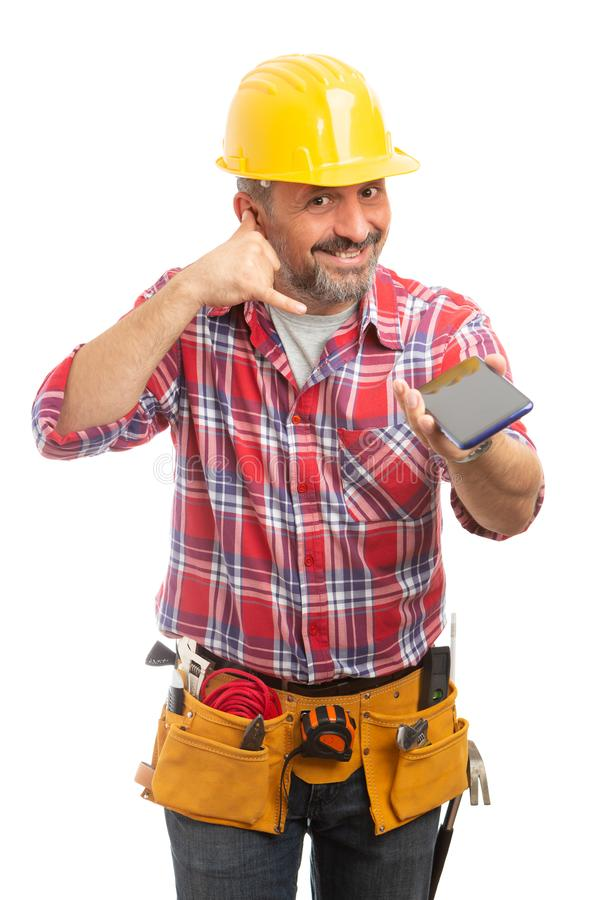 Construction worker making call us gesture royalty free stock image