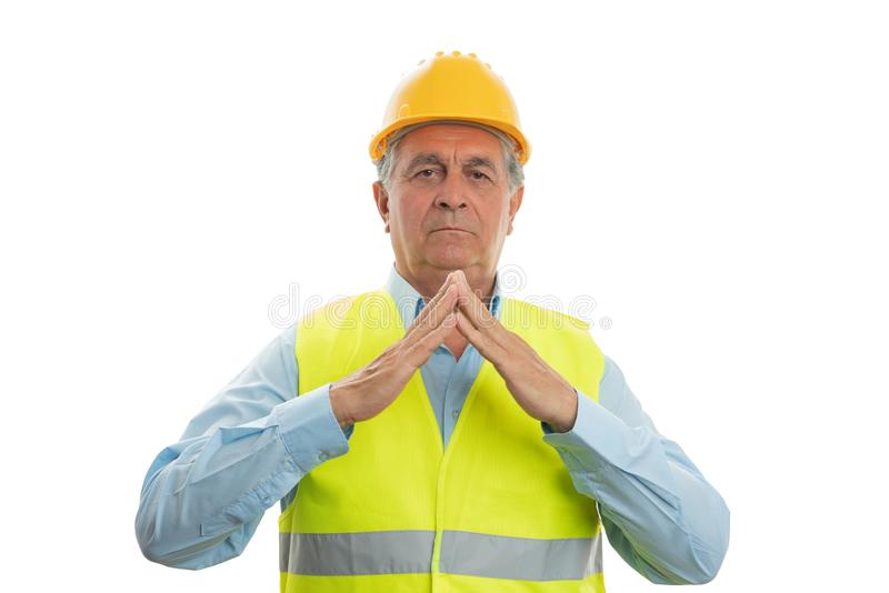 Construction worker making rooftop gesture with hands stock photography