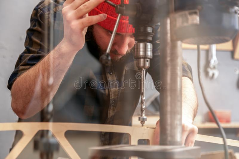 Construction Worker. Man drilling wood with  Drill machine on the table in renovation work at home. Home repair concepts, close up stock photos