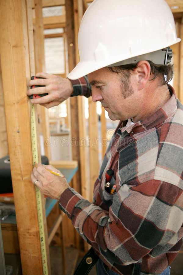 Download Construction Worker Measuring Stock Image - Image: 1758025