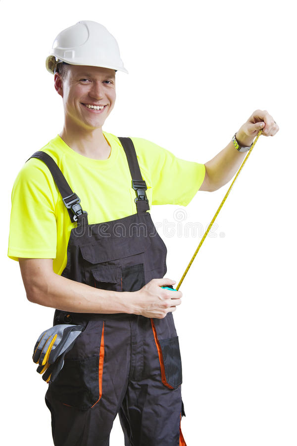 Construction worker measuring royalty free stock photography