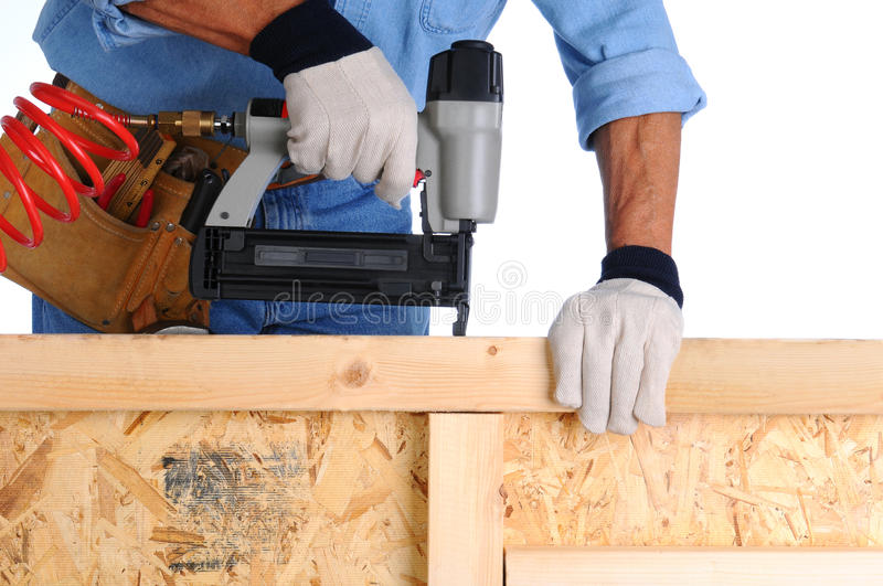 Construction Worker with Nail Gun royalty free stock image