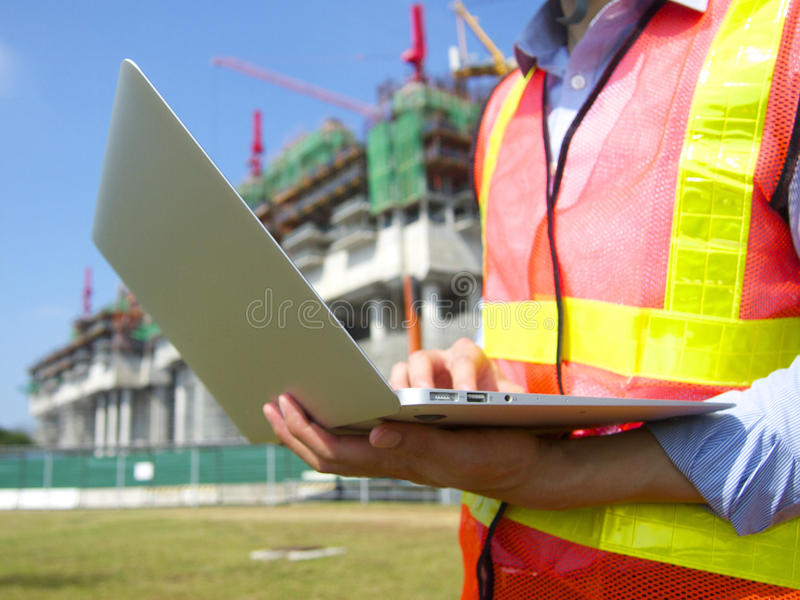 Construction worker with a pc stock photo