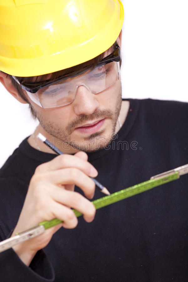 Construction worker with pen stock photos