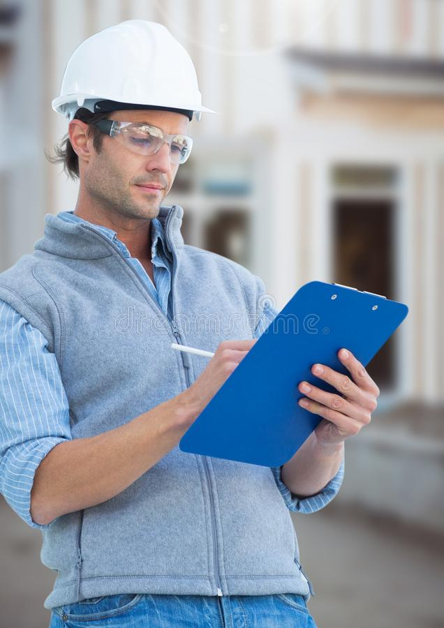 Construction Worker with pen chart in front of construction site stock image